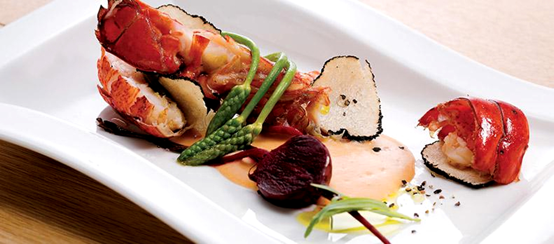 Lobster poêlé with summer truffles and light sauce : Simmer our lobster broth, add cream and pastis to make the sauce.